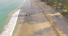 Yacht been washed aground at Kata Beach Phuket - stock footage