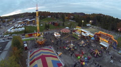 Drone shot of illuminated carnival rides during the evening Stock Footage