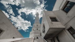 The sun breaks through the clouds over a white mosque. Kazakhstan - 4K Timelapse Stock Footage