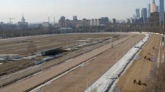 Top view of equine running on moscow hippodrome in early spring Moscow City - stock footage