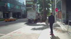 Businessman on an electric skateboard Stock Footage