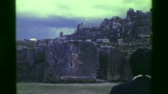 1977: Scientist couples touring Saksaywaman Inca civilization ancient ruins. - stock footage