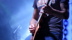 Band guy on rock concert musician play guitar on a stage in lumiere Stock Footage