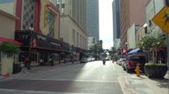 Biking on Flagler Street Miami Stock Footage