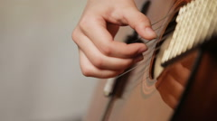 Woman's hands playing acoustic guitar Stock Footage