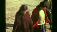 1977: Modern Inca natives old stone laden part of town local residents. CUSCO, - stock footage