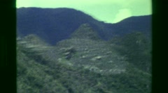 1977: Machu Picchu green forested mountains surrounding area river below. CUSCO, Stock Footage