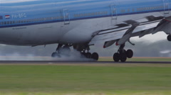 Large jumbo landing with landing gear in close-up Stock Footage