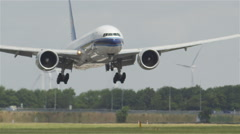 Mighty Boeing 777 head on during landing Stock Footage