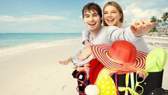Happy couple ready for vacation. - stock photo