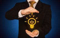 Sales guy has bright idea in the hand - stock photo