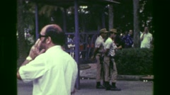 1977: Police government federal security guards paired in twos patrol public Stock Footage