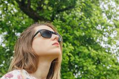 Girl in sunglasses rain looking at the sky Kuvituskuvat