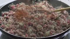 FRYING MINCED MEAT WITH ONION AND RICE - stock footage