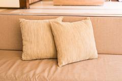 Cozy sofa with pillows. Living room interior and home decor concept - stock photo