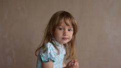 Little girl enjoying crisps - stock footage