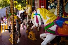 Carousel with Horses on a carnival Merry Go Round Stock Photos