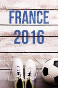 Soccer ball, cleats and France 2016 sign, studio shot Stock Photos