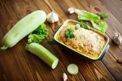 Casserole with cheese and zucchini Stock Photos