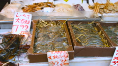 Crabs and Lobsters in the china town fish market in New York City Stock Footage