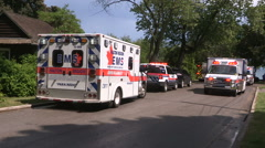 Ambulances and emergency services at scene with lights flashing Stock Footage