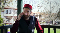 Ottoman Turkish man is talking by phone - stock footage