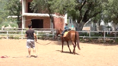Two years old boy riding Stock Footage