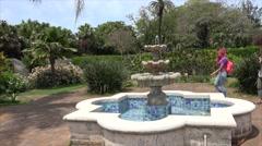 Tourist girls in the Persian garden of Hamilton Botanical Gardens, Bermuda - stock footage