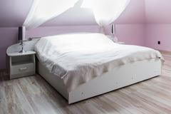 Pink bedroom with double bed - stock photo