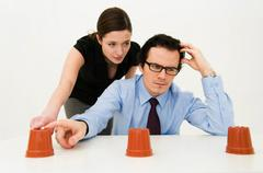 Couple ponder location of hidden item - stock photo