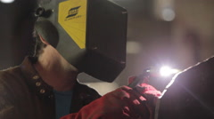 Worker Using a Welding Torch to cut Metal Stock Footage