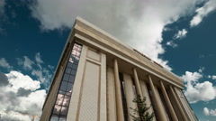 Clouds over the building of the concert hall of the administrative and business Stock Footage