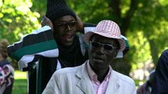 The natives of Somalia sing in a City Park. Slow Motion. - stock footage