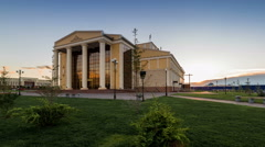 Sunset on a background of drama theater building. Kazakhstan - 4K Timelapse - stock footage