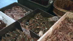 Worker gathering blue crabs in the china town fish market during the summer Stock Footage