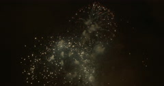 Red and Gold Fireworks Flaring In The Night Sky Stock Footage