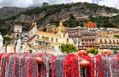 Fishing nets on the beach of Positano, view of Dome. Stock Photos