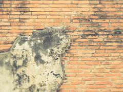 Old red grunge brick wall (Vintage filter effect used) Stock Photos