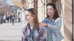 Cute girl and boy with long hair posing on street Stock Footage