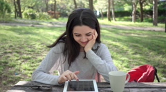 University student using digital tablet at park Stock Footage