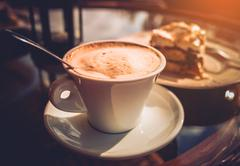Cappuccino Coffee and Tasty Cake. Outdoor Garden Table Stock Photos