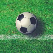 Soccer Ball on green grass field from top view - stock photo