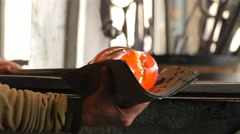 Glassworks glass manufacturing process - glass rolling on the marver Stock Footage