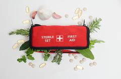 Herbs in first aid kit Stock Photos