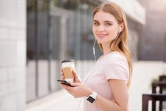 Modern young woman using new devices - stock photo