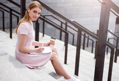 Modern young woman using new devices Stock Photos