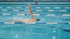 Swimmer swimming in the waterpool Stock Footage