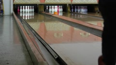 A slow motion shot of a bowling ball hitting pins - stock footage
