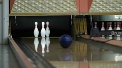 A slow motion shot of ball hitting the bowling pins - stock footage