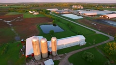 Scenic rural landscape at dusk, springtime fields, farms, silos - stock footage